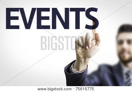 Business man pointing to transparent board with text: Events