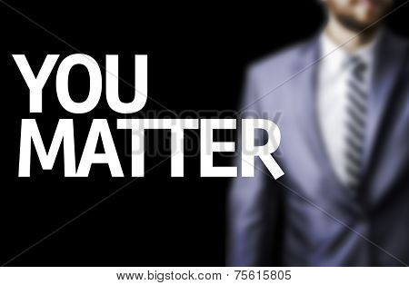 You Matter written on a board with a business man on background