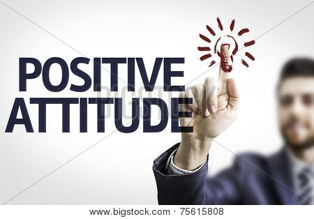 Business man pointing to transparent board with text: Positive Attitude