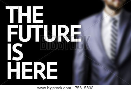 The Future Is Here written on a board with a business man on background