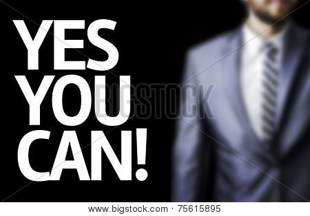 Yes You Can! written on a board with a business man on background