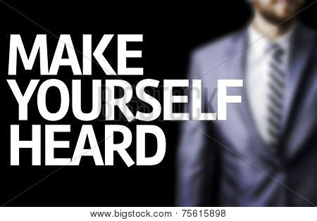Make Yourself Heard written on a board with a business man on background