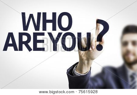 Business man pointing to transparent board with text: Who are You?