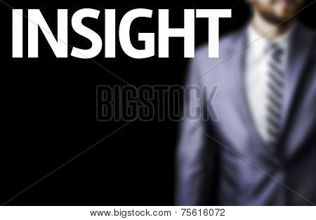 Insight written on a board with a business man on background