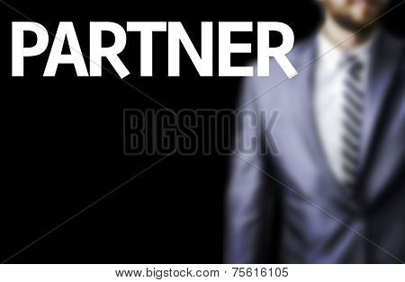 Partner written on a board with a business man on background