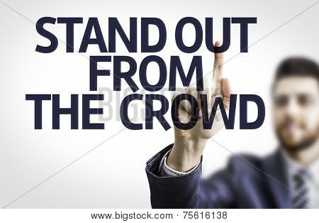 Business man pointing to transparent board with text: Stand Out From The Crowd