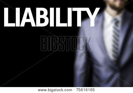 Liability written on a board with a business man on background