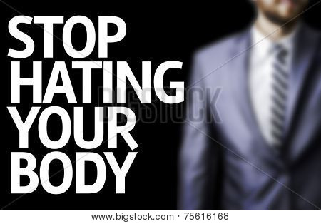 Stop Hating Your Body written on a board with a business man on background