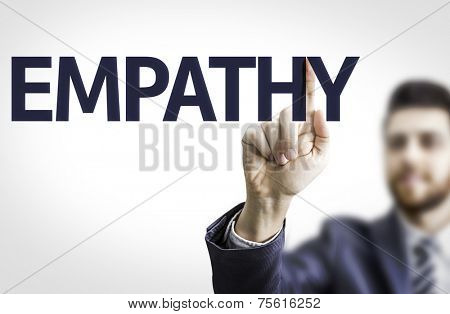 Business man pointing to transparent board with text: Empathy