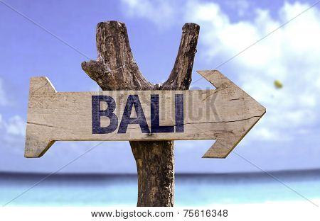Bali wooden sign with a beach on background