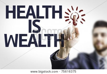 Business man pointing to transparent board with text: Health is Wealth