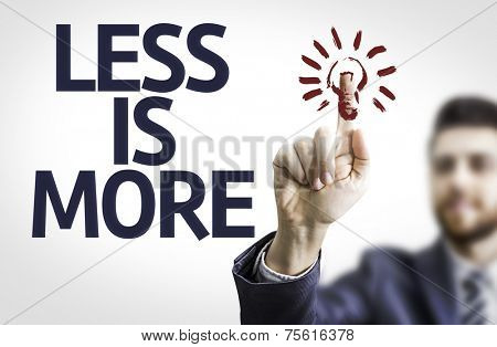 Business man pointing to transparent board with text:Less is More