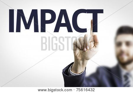 Business man pointing to transparent board with text: Impact
