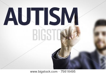 Business man pointing to transparent board with text: Autism
