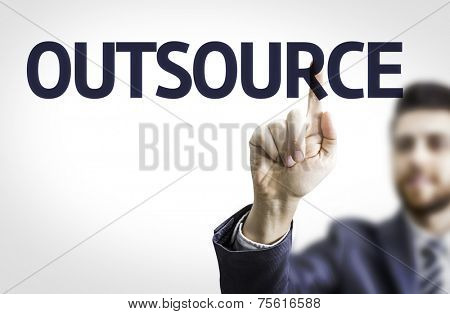 Business man pointing to transparent board with text: Outsource