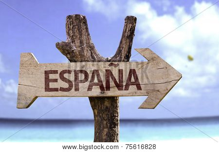 Spain (In Spanish) wooden sign with a beach on background