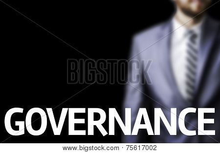 Governance written on a board with a business man on background