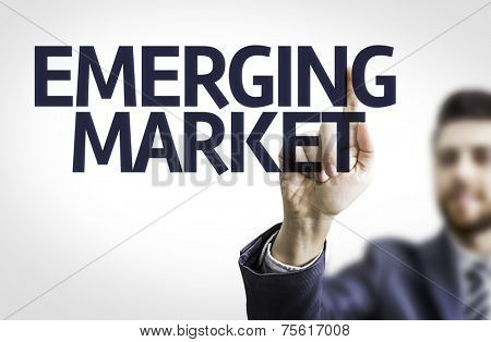 Business man pointing to transparent board with text: Emerging Market
