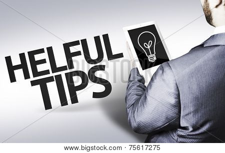 Business man with the text Helpful Tips in a concept image