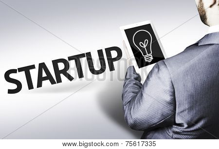 Business man with the text Startup in a concept image