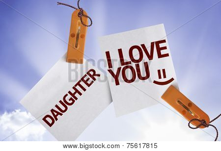 Daughter I Love You on Paper Note on sky background