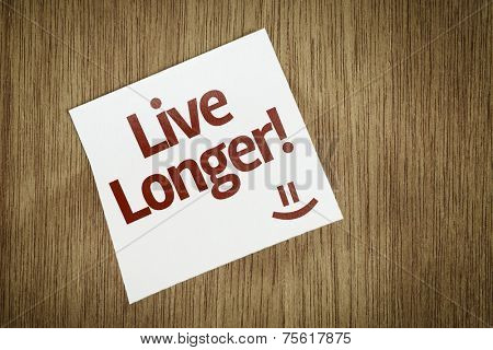 Live Longer on Paper Note with texture background