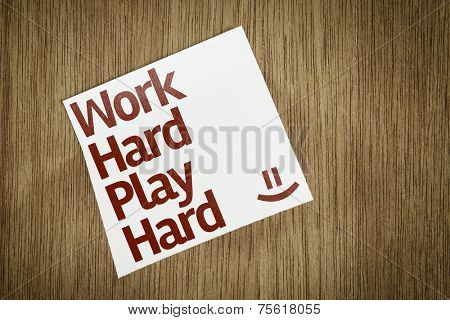Work Hard Play Hard on Paper Note with texture background