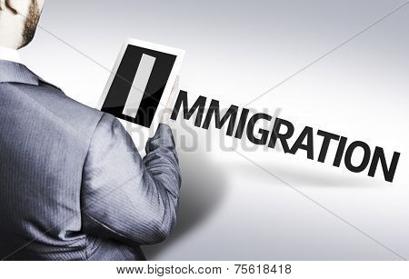 Business man with the text Immigration in a concept image