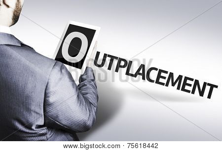 Business man with the text Outplacement in a concept image