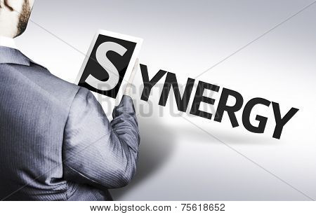 Business man with the text Synergy in a concept image
