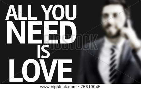 Business man with the text All you Need is Love in a concept image