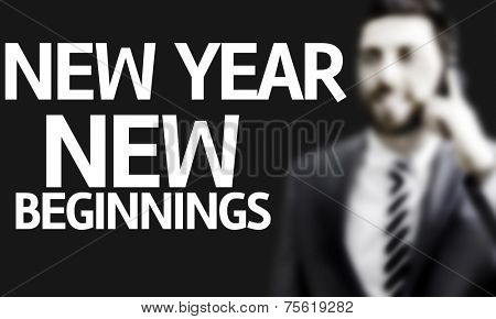 Business man with the text New Year New Beginnings in a concept image