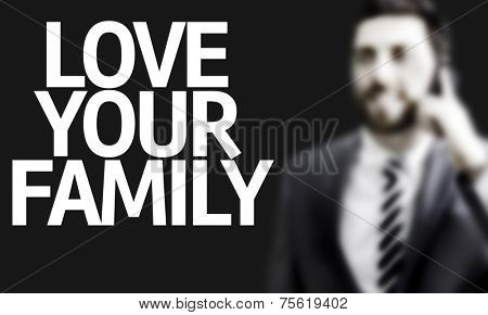 Business man with the text Love Your Family in a concept image