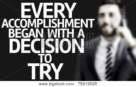 Business man with the text Every Accomplishment Began With a Decision to Try in a concept image