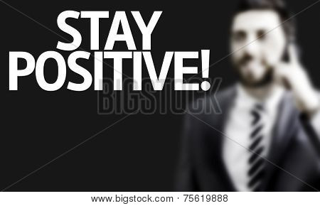 Business man with the text Stay Positive in a concept image