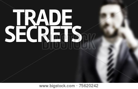 Business man with the text Trade Secrets in a concept image
