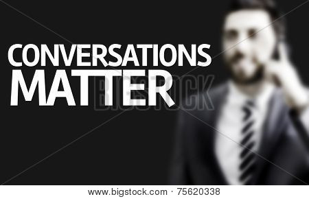 Business man with the text Conversations Matter in a concept image