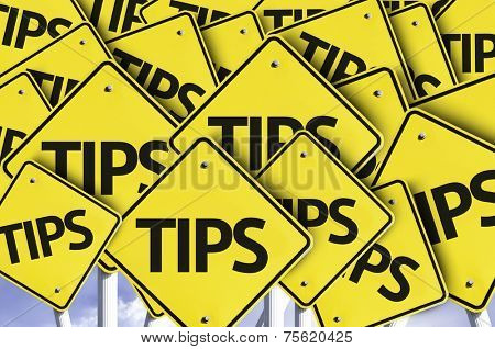 Tips written on multiple road sign