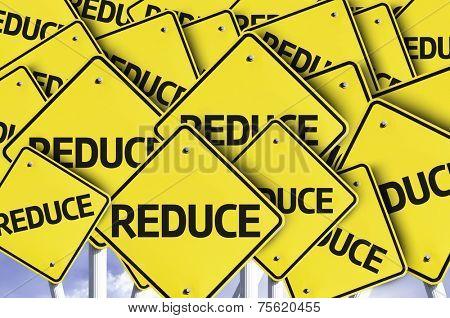 Reduce written on multiple road sign