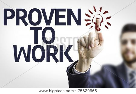 Business man pointing to transparent board with text: Proven to Work