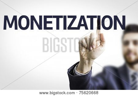 Business man pointing to transparent board with text: Monetization