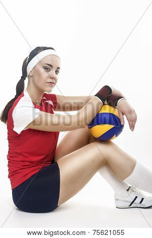 Portrait Of Caucasian Professional Female Volleyball Player Equipped In Volleyball Outfit  With Ball