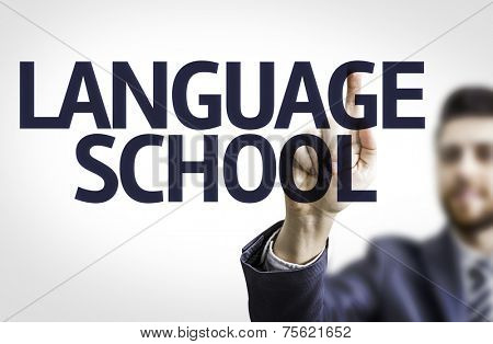 Business man pointing to transparent board with text: Language School