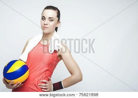 Caucasian Female Professional Volleyball Athlete Holding Ball. Over Gray Background