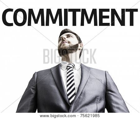 Business man with the text Commitment in a concept image