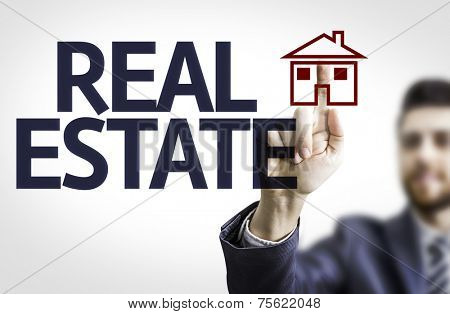 Business man pointing to transparent board with text: Real Estate