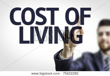Business man pointing to transparent board with text: Cost of Living