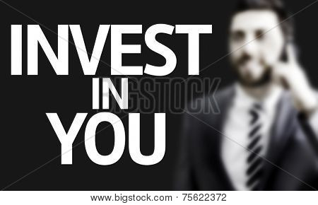 Business man with the text Invest in You in a concept image