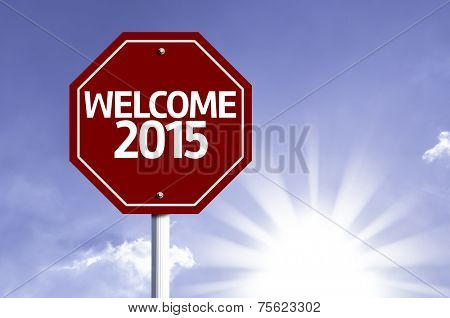 Welcome 2015 written on red road sign with a sky on background
