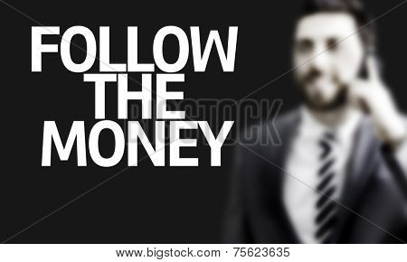 Business man with the text Follow the Money in a concept image